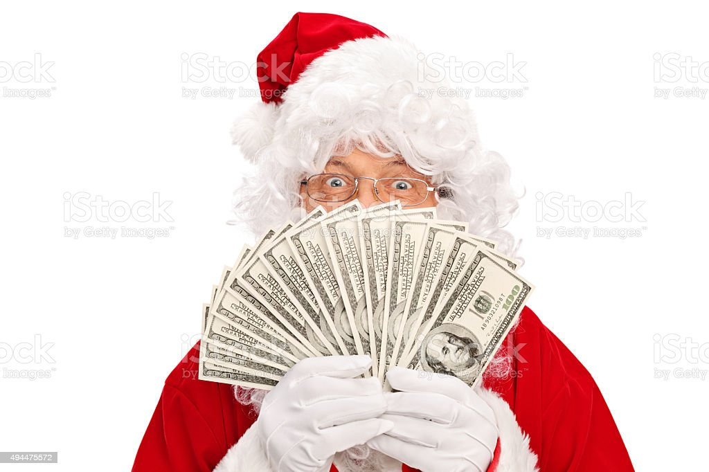 Santa Claus covering his face with money stock photo