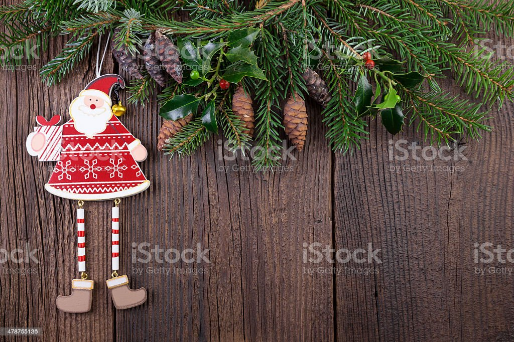 Santa Claus Decoration with Fir Branch over old Wooden Background stock photo