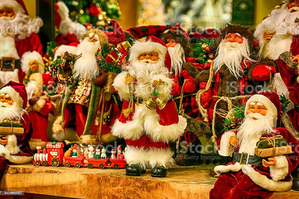 Santa Claus dolls in a Christmas store stock photo