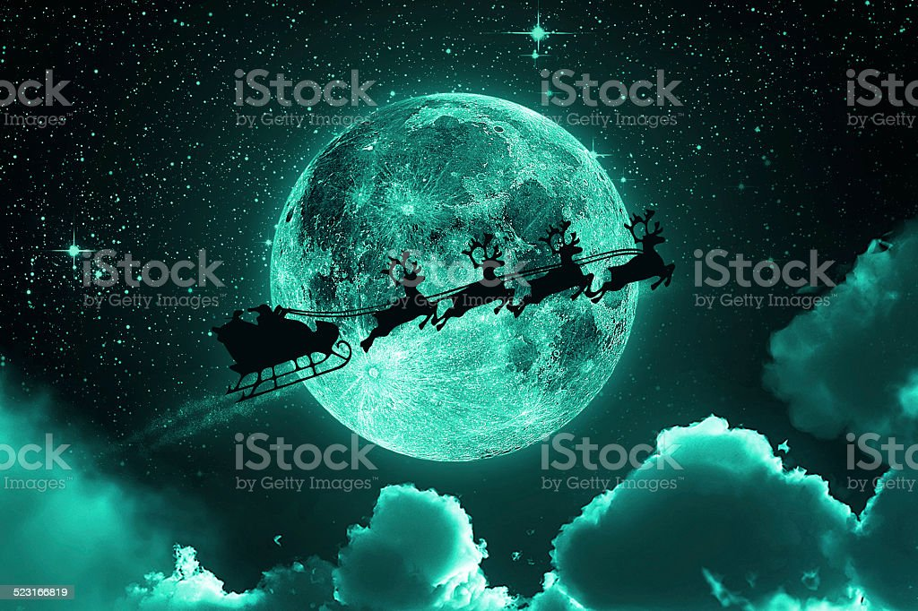 Santa Claus Flying On The Sky - Green stock photo