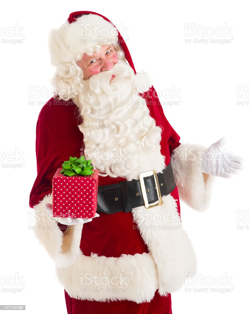 Santa Claus Gesturing While Holding Gift Box royalty-free stock photo