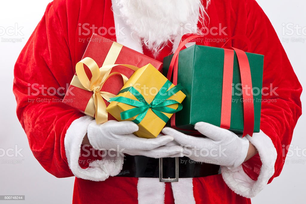 Santa Claus gloved hands holding  giftbox stock photo