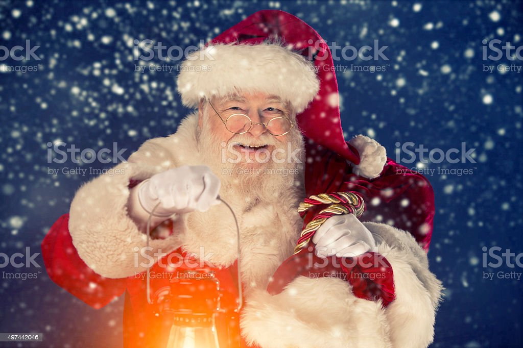 Santa Claus happy that it is snowing stock photo