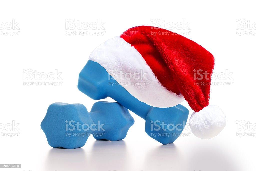 Santa Claus Hat on blue dumbbells stock photo