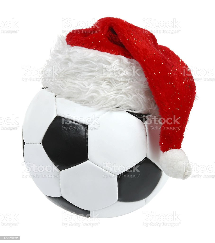 Santa Claus hat on the soccer ball royalty-free stock photo