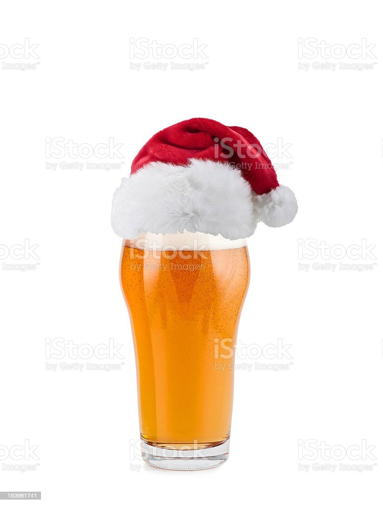 Santa Claus hat with beer royalty-free stock photo