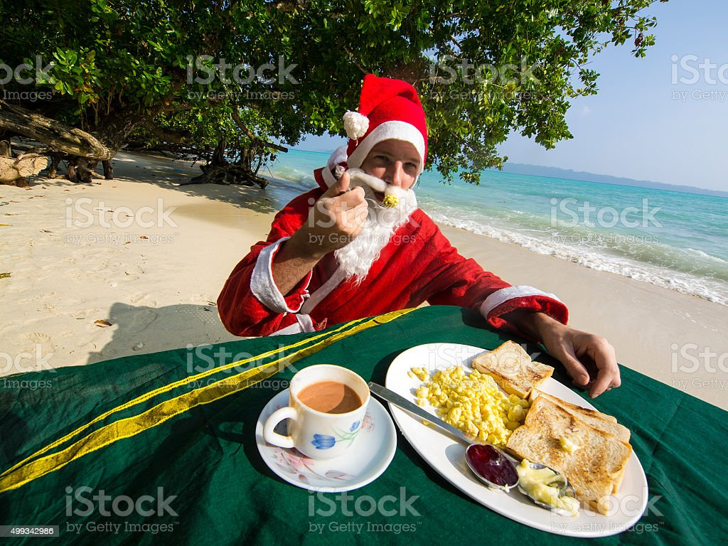 Santa Claus  having Breakfast at Vijaynagar beach, India stock photo