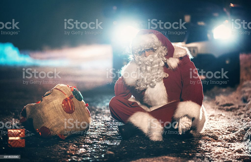 Santa Claus having car trouble. stock photo