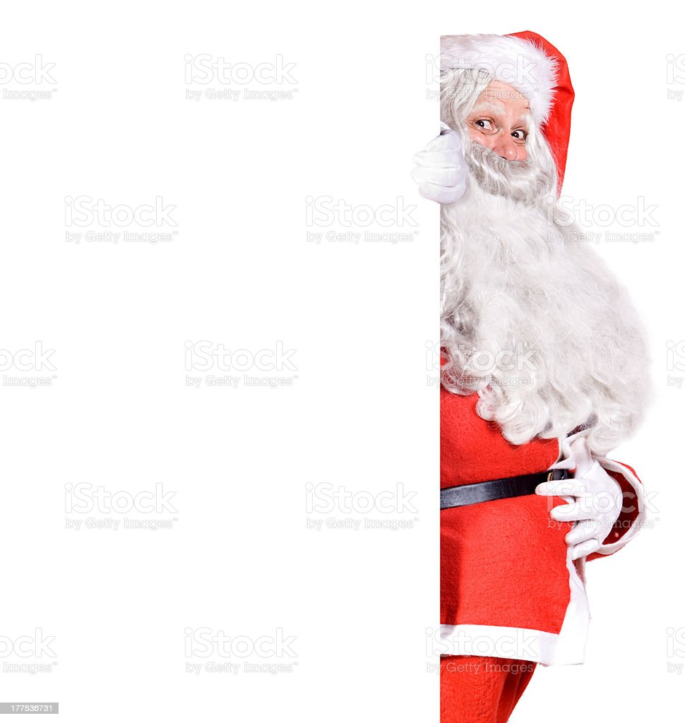 Santa Claus holding a blank sign royalty-free stock photo