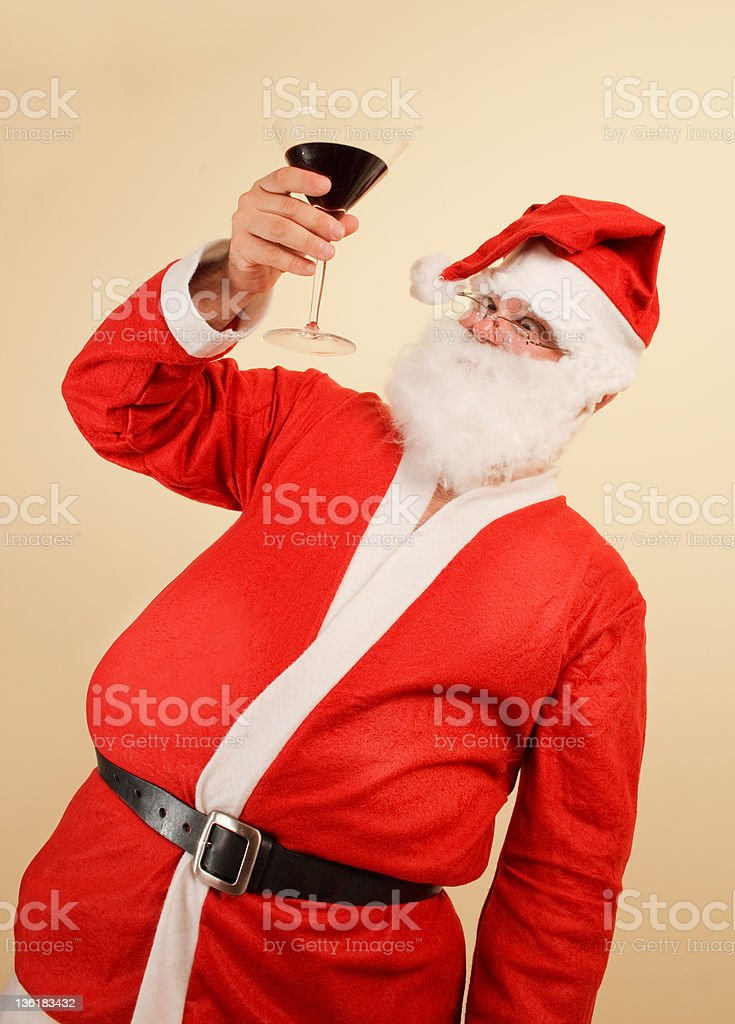 santa claus holding a glass of wine royalty-free stock photo