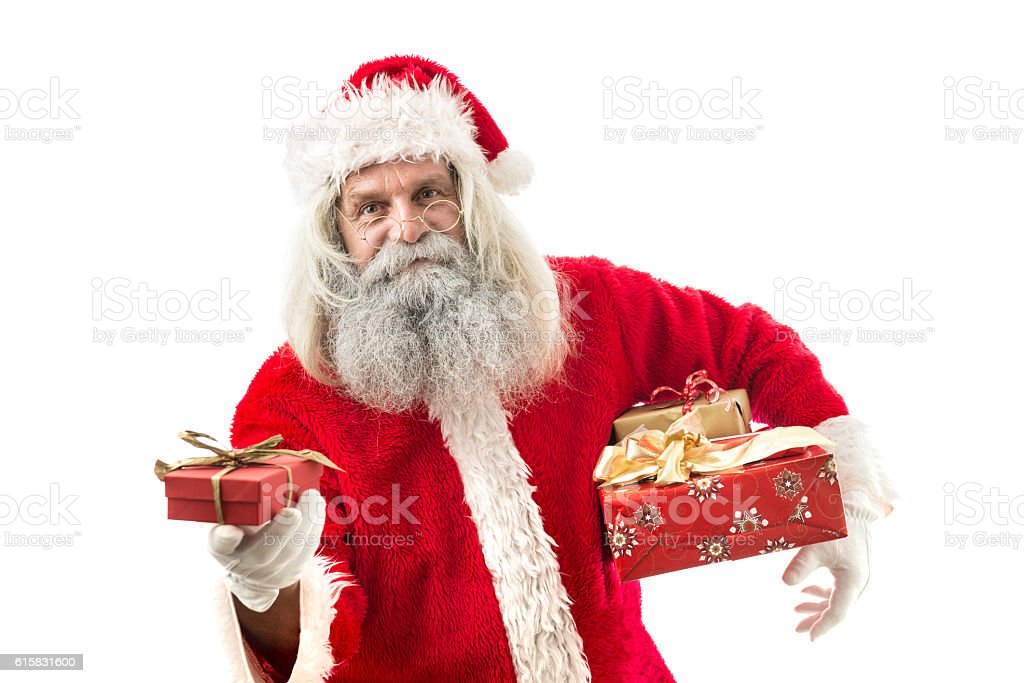 santa claus holding a present isolated on white stock photo