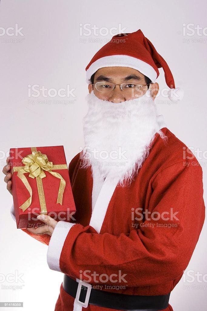 Santa Claus Holding A Present royalty-free stock photo