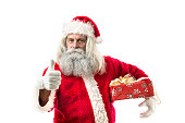 santa claus holding a present with thumb up