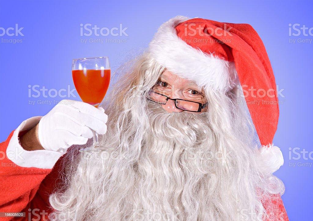 Santa Claus holding a wineglass royalty-free stock photo