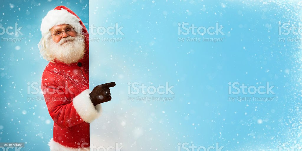 Santa Claus holding banner with blue space for Your Text stock photo