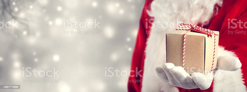 Santa Claus holding gift stock photo