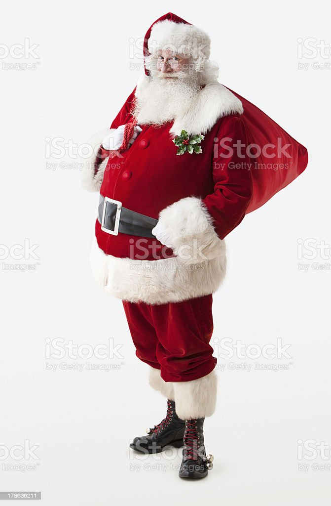 Santa Claus holding his gift bag stock photo