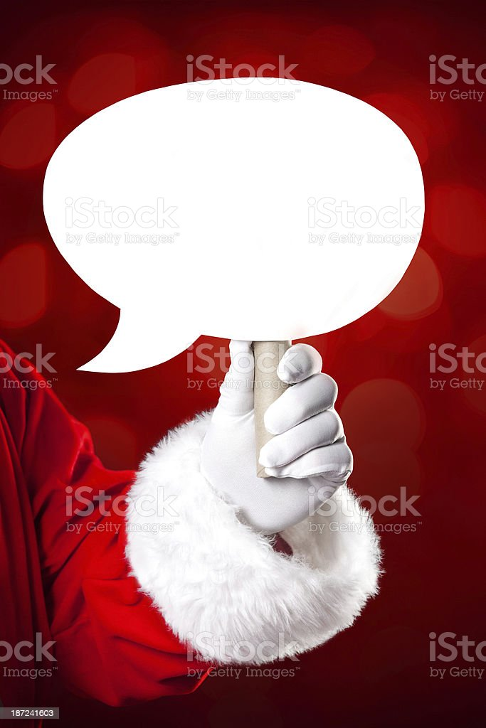 Santa Claus holding speech bubble in his hand royalty-free stock photo