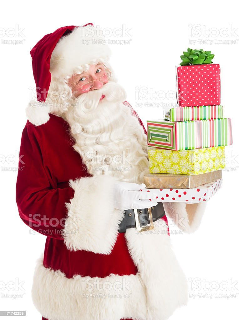 Santa Claus Holding Stack Of Gift Boxes royalty-free stock photo
