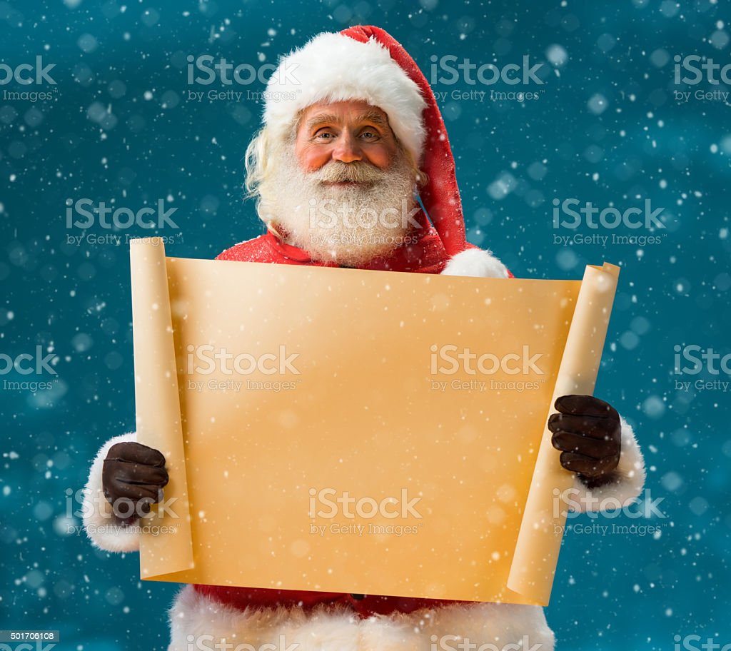 Santa Claus holding vintage paper blank sign stock photo