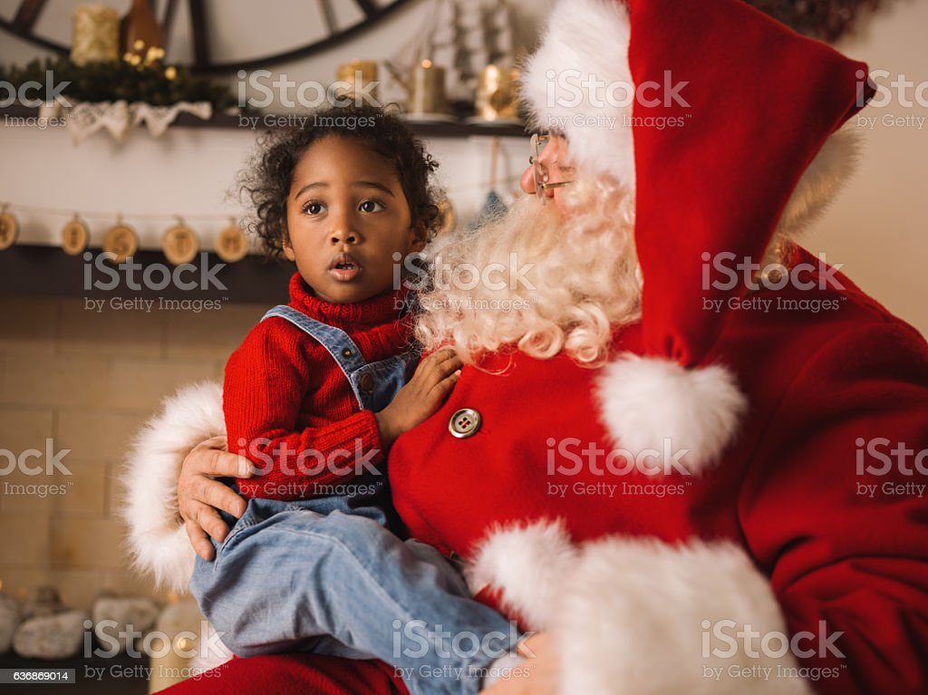 Santa Claus hugging with cute girl at Home stock photo