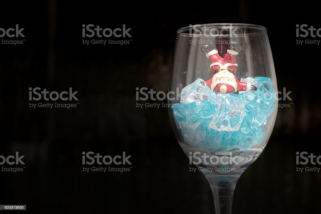 Santa Claus in a glass of wine with ice stock photo
