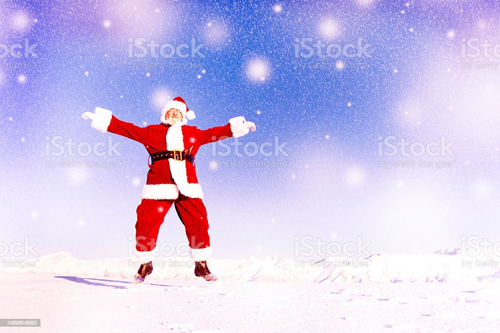 Santa Claus in a Winter Wonderland Jumping Happiness Concept stock photo