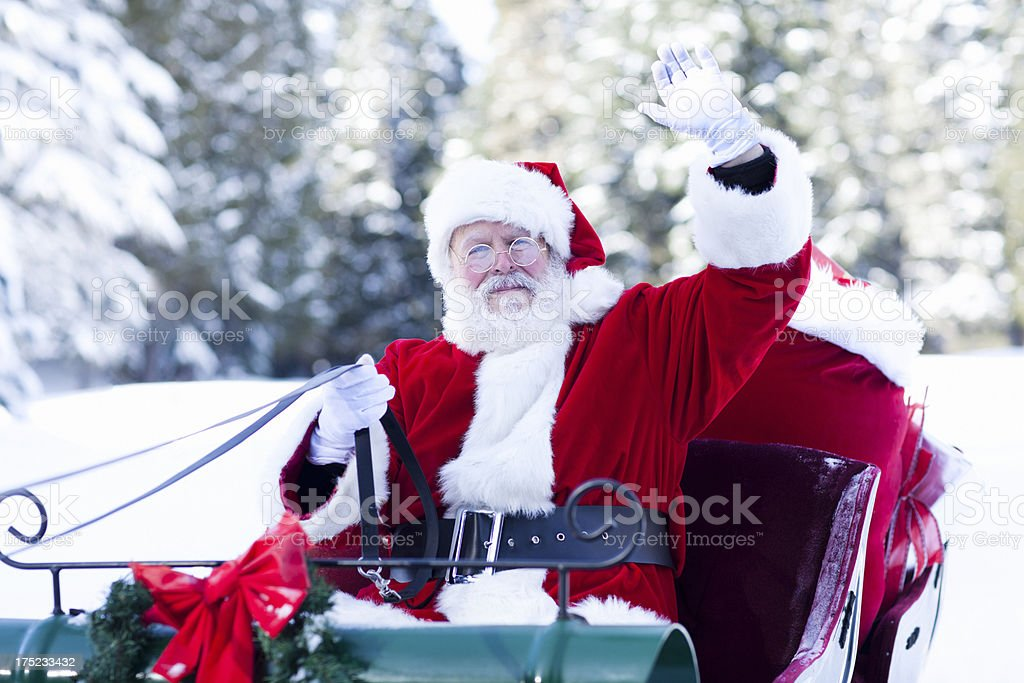 Santa Claus in His Sleigh Waving stock photo