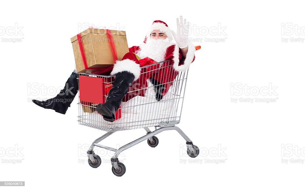 Santa Claus in shopping cart stock photo
