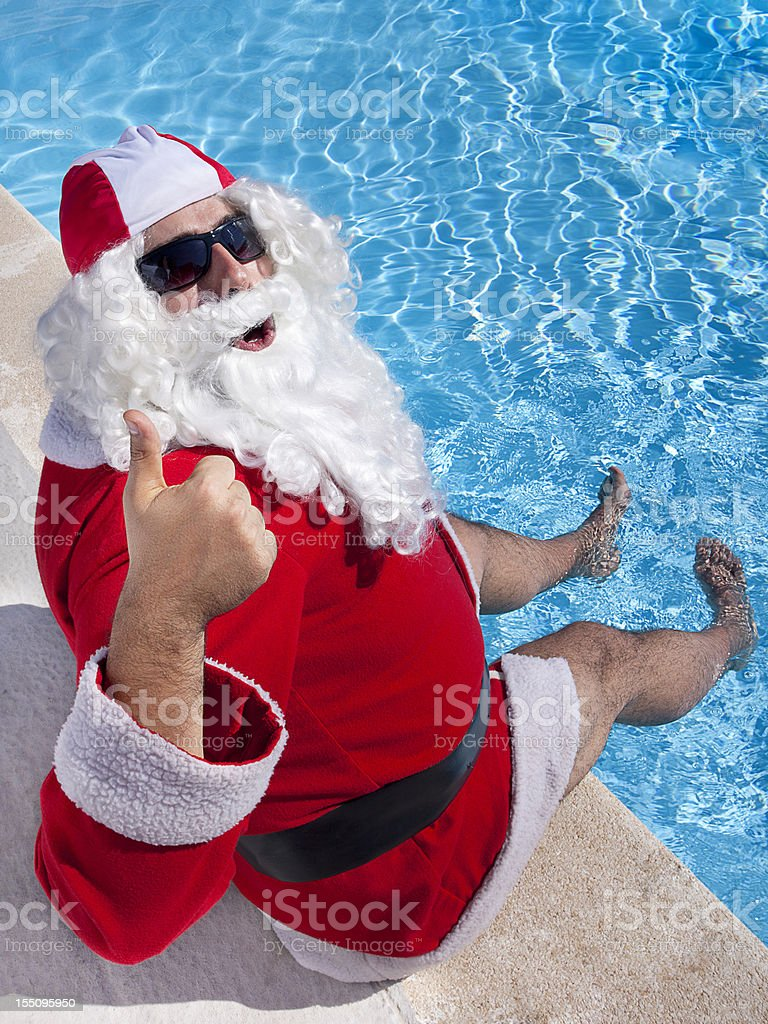Santa Claus in the pool stock photo