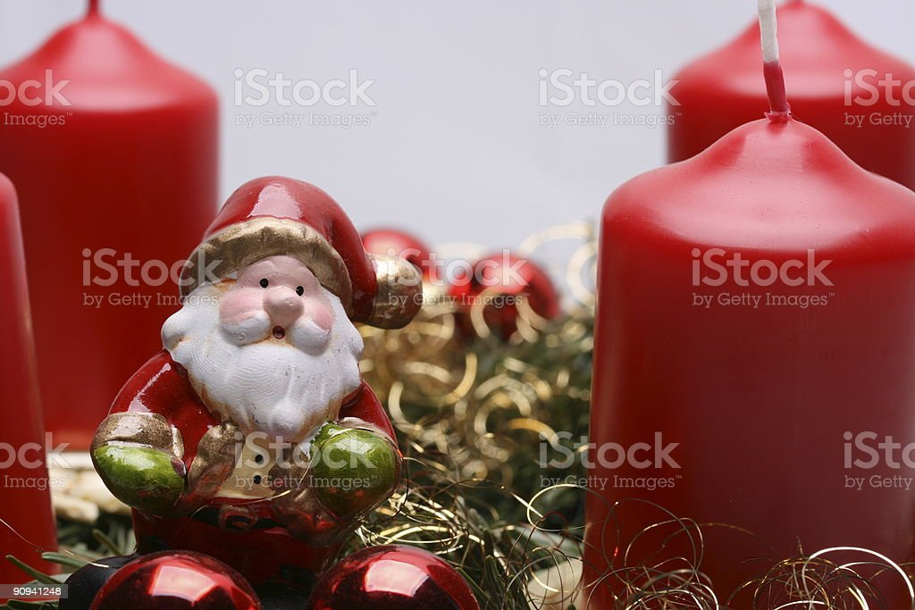 Santa Claus in Wreath and Red Candles royalty-free stock photo