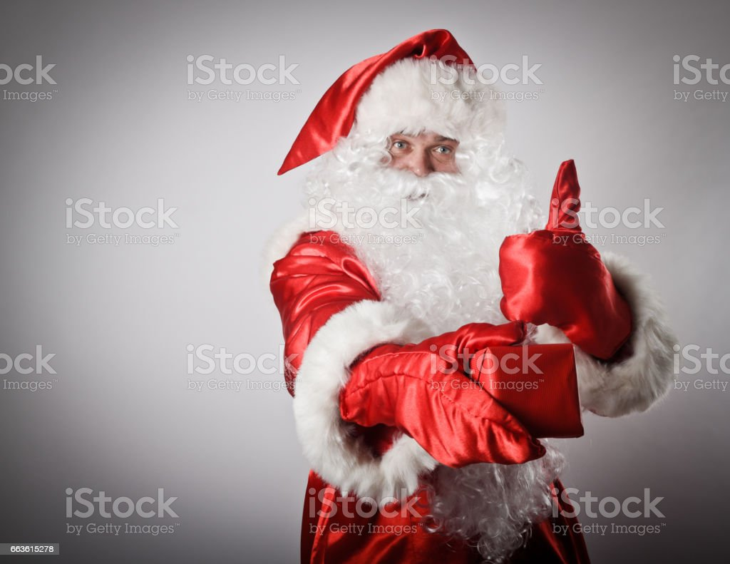 Santa Claus is giving Christmas gift stock photo