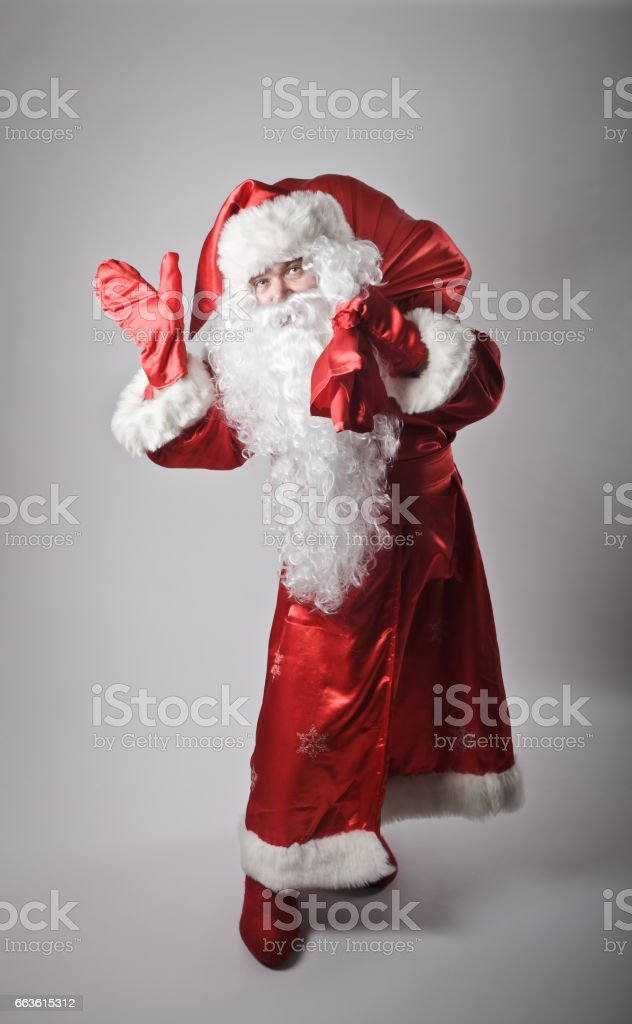 Santa Claus is going with sack somewhere. stock photo