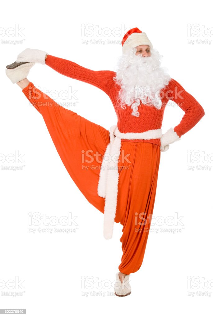 Santa Claus is making yoga stock photo