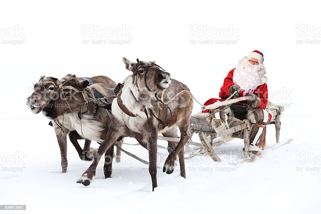 Santa Claus is sitting in a deer sleigh stock photo