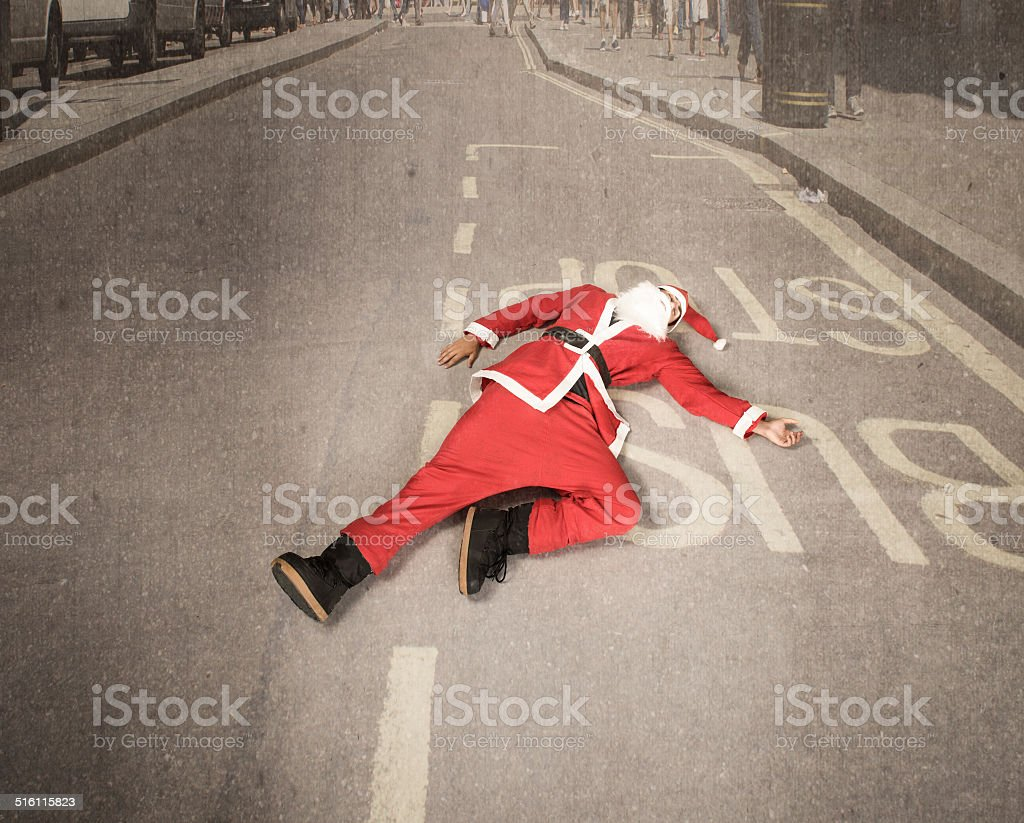 Santa Claus lying down in middle of the road stock photo