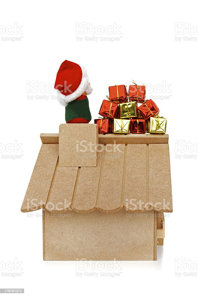 Santa Claus on roof with gifts royalty-free stock photo