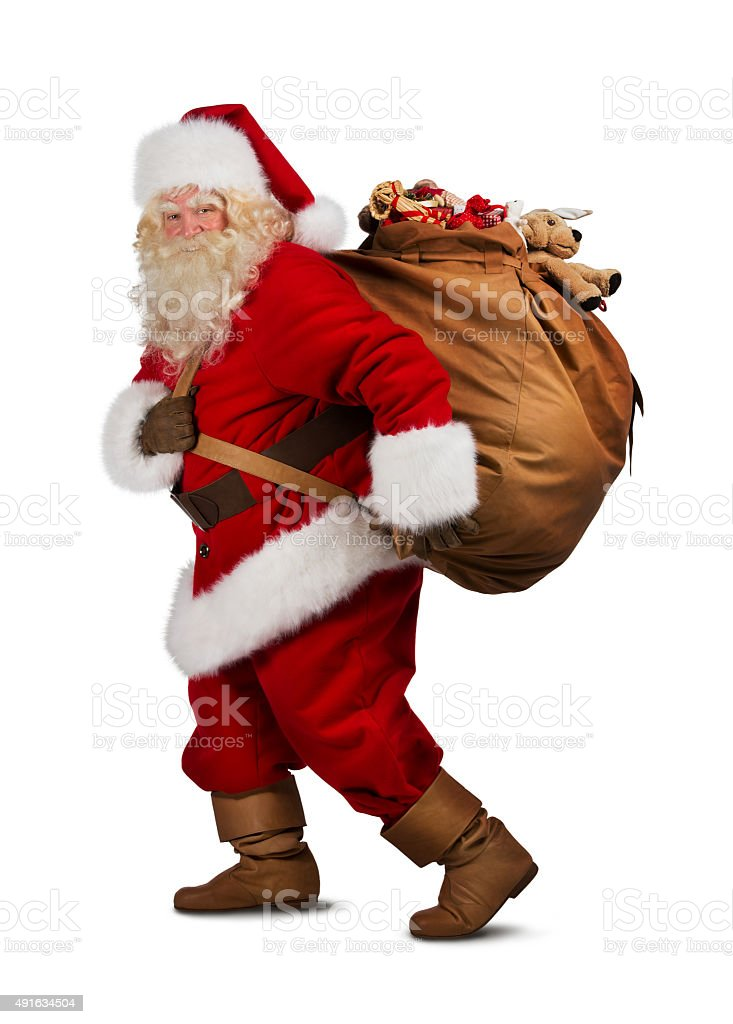 Santa Claus on the run to delivery christmas gifts isolated stock photo
