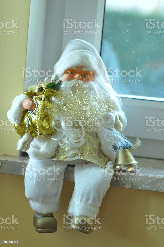 Santa Claus on the windowsill stock photo