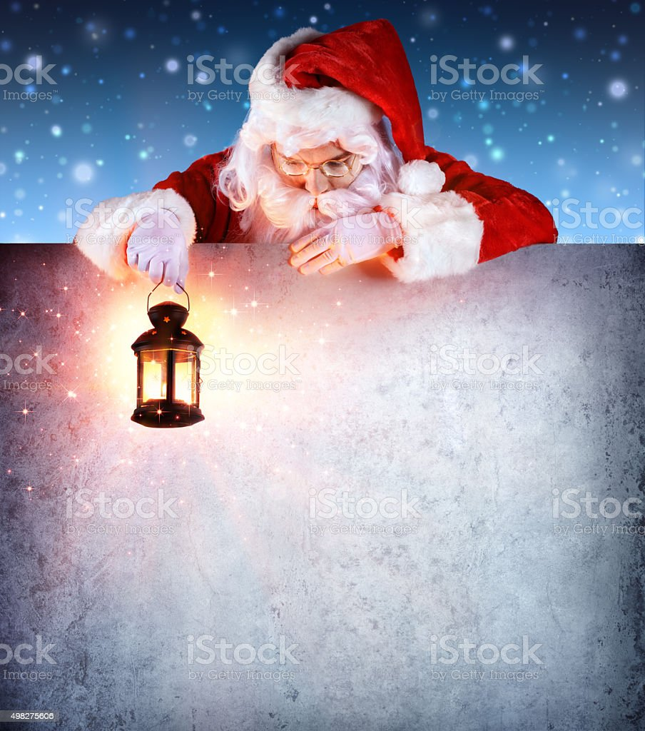 Santa Claus On Vintage Billboard With Lantern stock photo