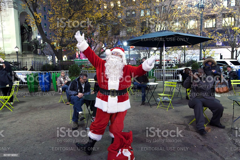Santa Claus outside of Herald Square NYC stock photo