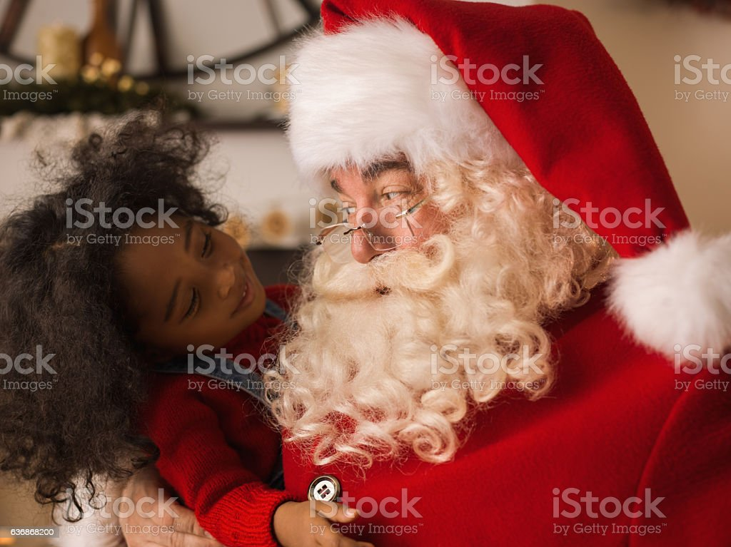 Santa Claus playing with cute child stock photo