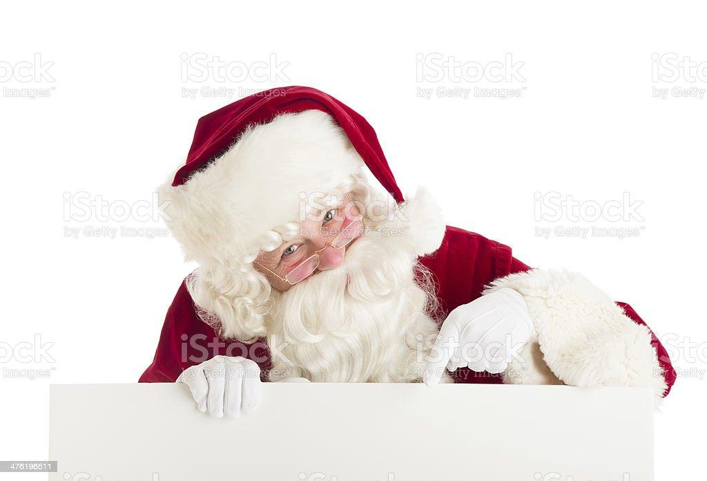 Santa Claus Pointing At Blank Sign royalty-free stock photo