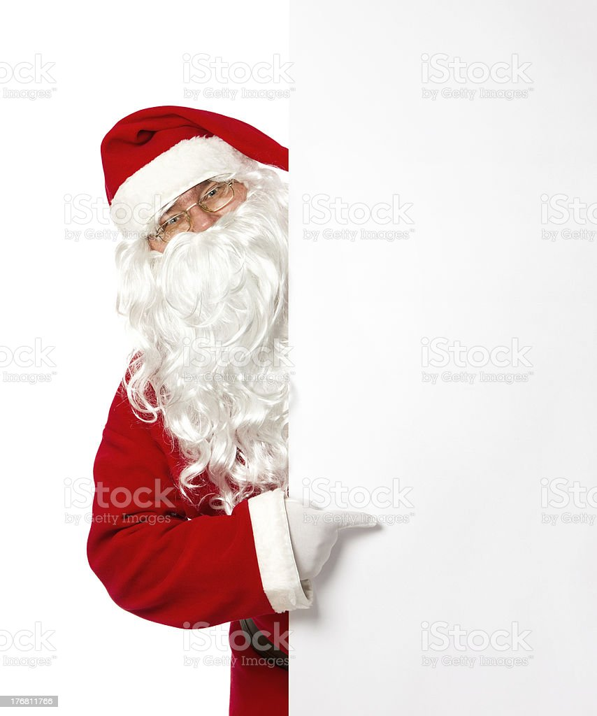 Santa Claus pointing on a blank banner royalty-free stock photo