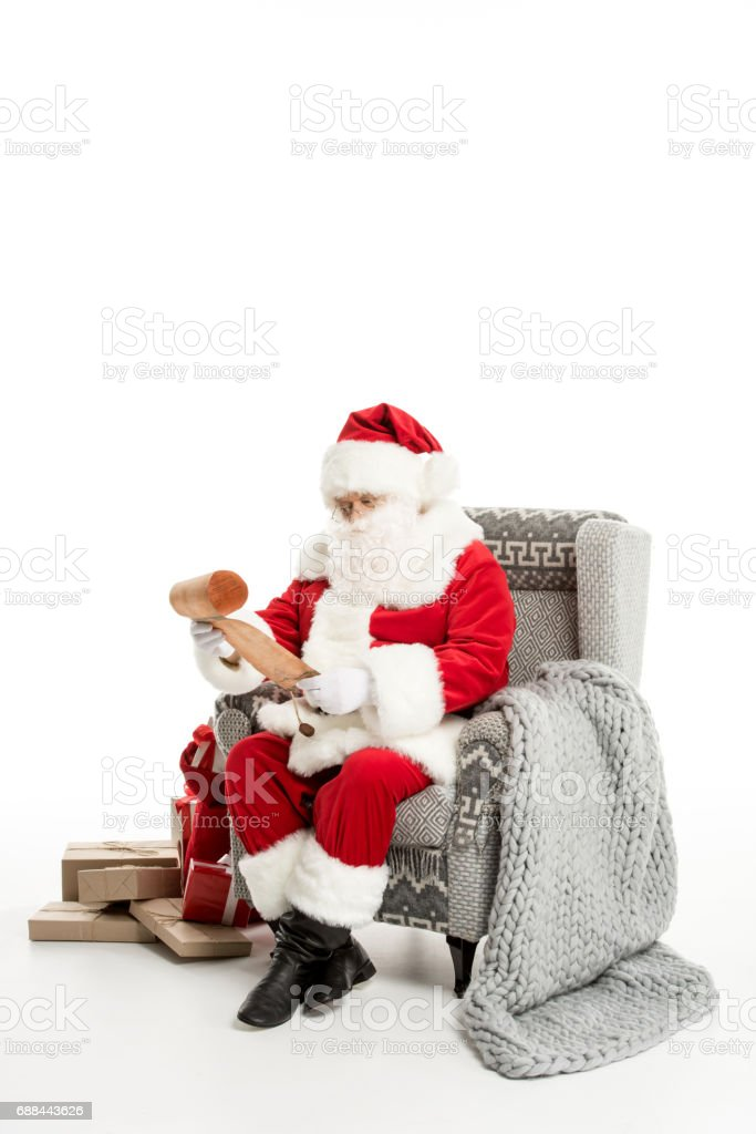 Santa Claus reading Christmas wishlist stock photo