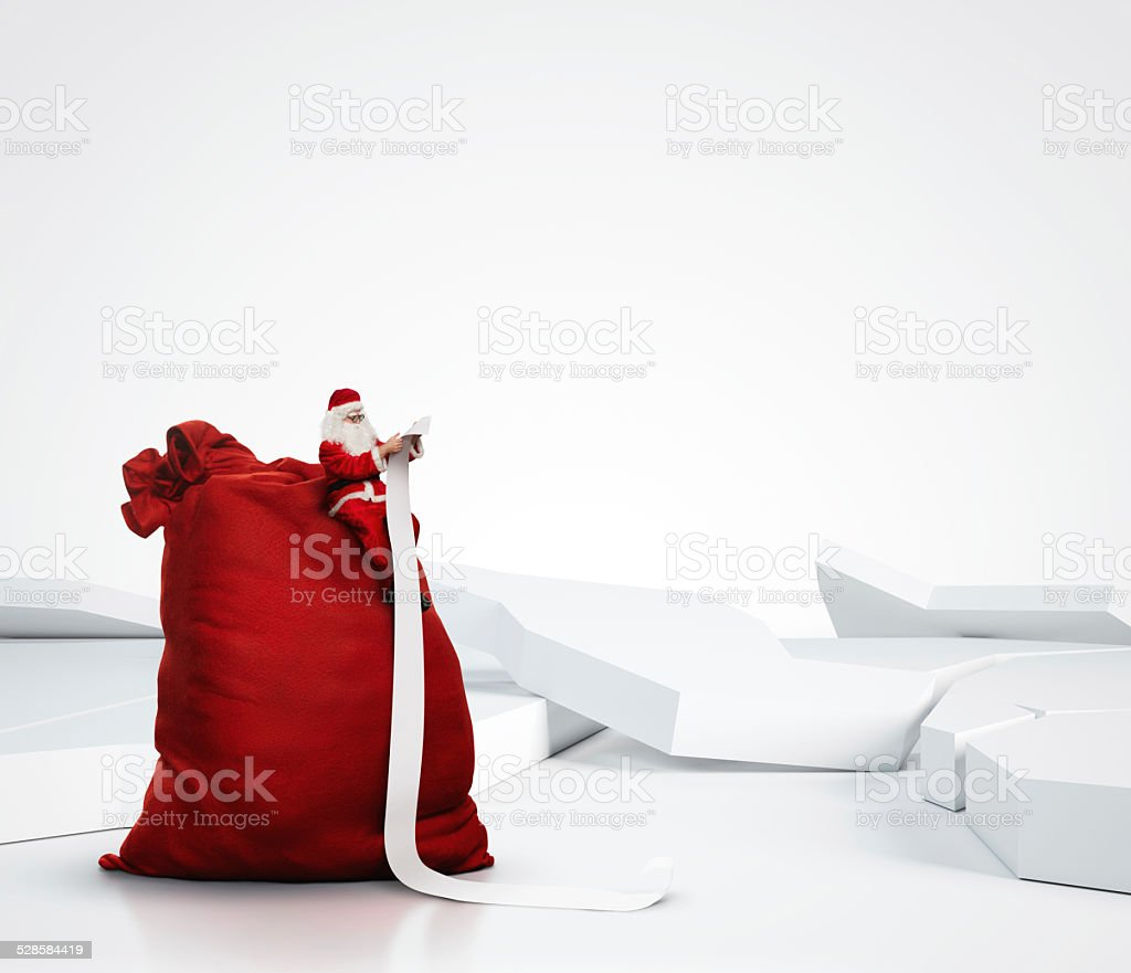 Santa Claus reading long list stock photo