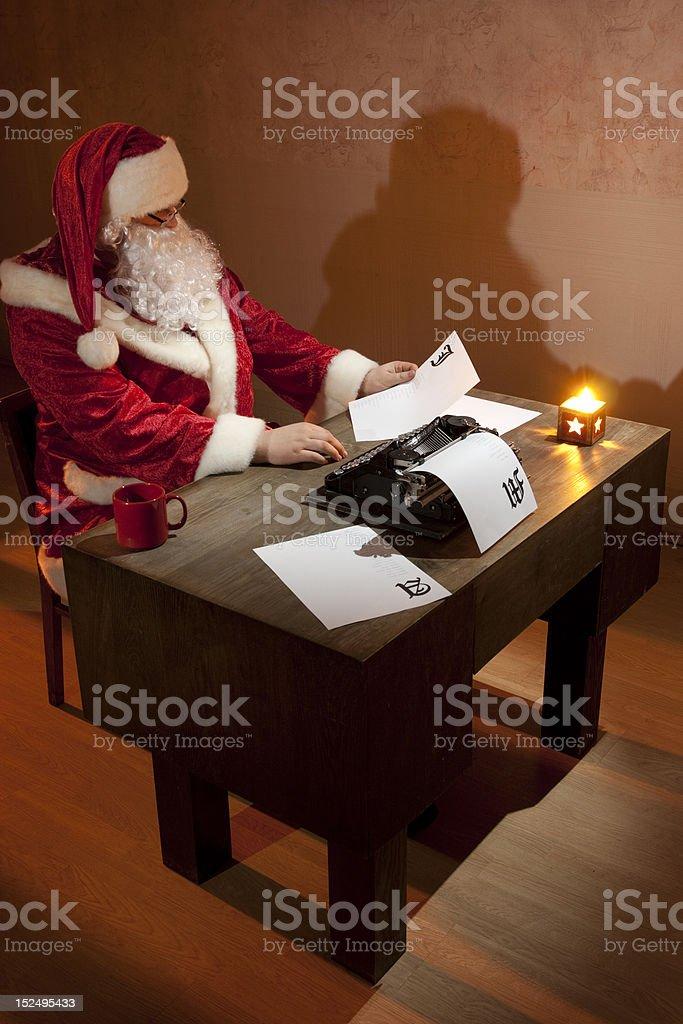 Santa Claus reading royalty-free stock photo
