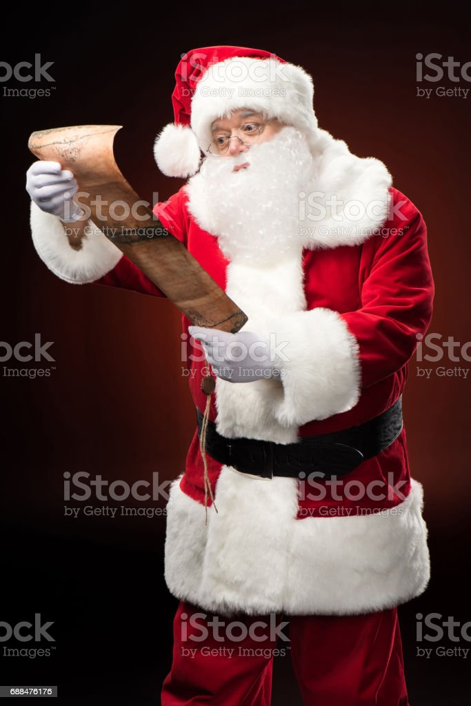 Santa Claus reading wishlist stock photo