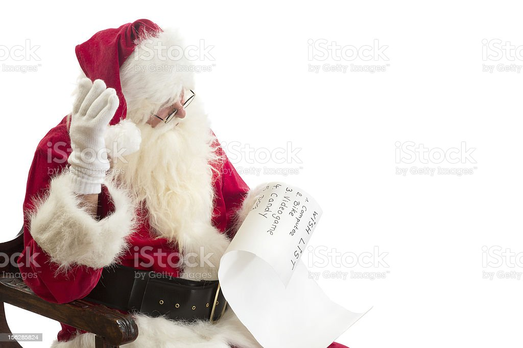 Santa Claus receives a wish list royalty-free stock photo