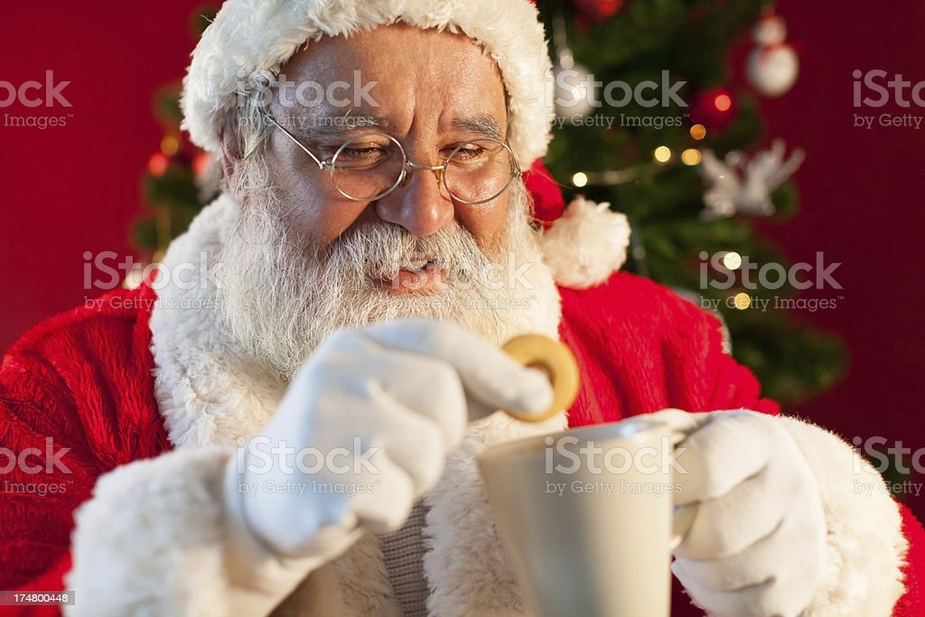 Santa Claus resting with cookie and coffee. royalty-free stock photo